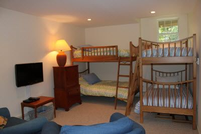 Bunkroom with 4 beds, 2 sleeper chairs, and HDTV/DVD