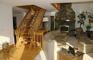 Living Room, hearth and loft stairs