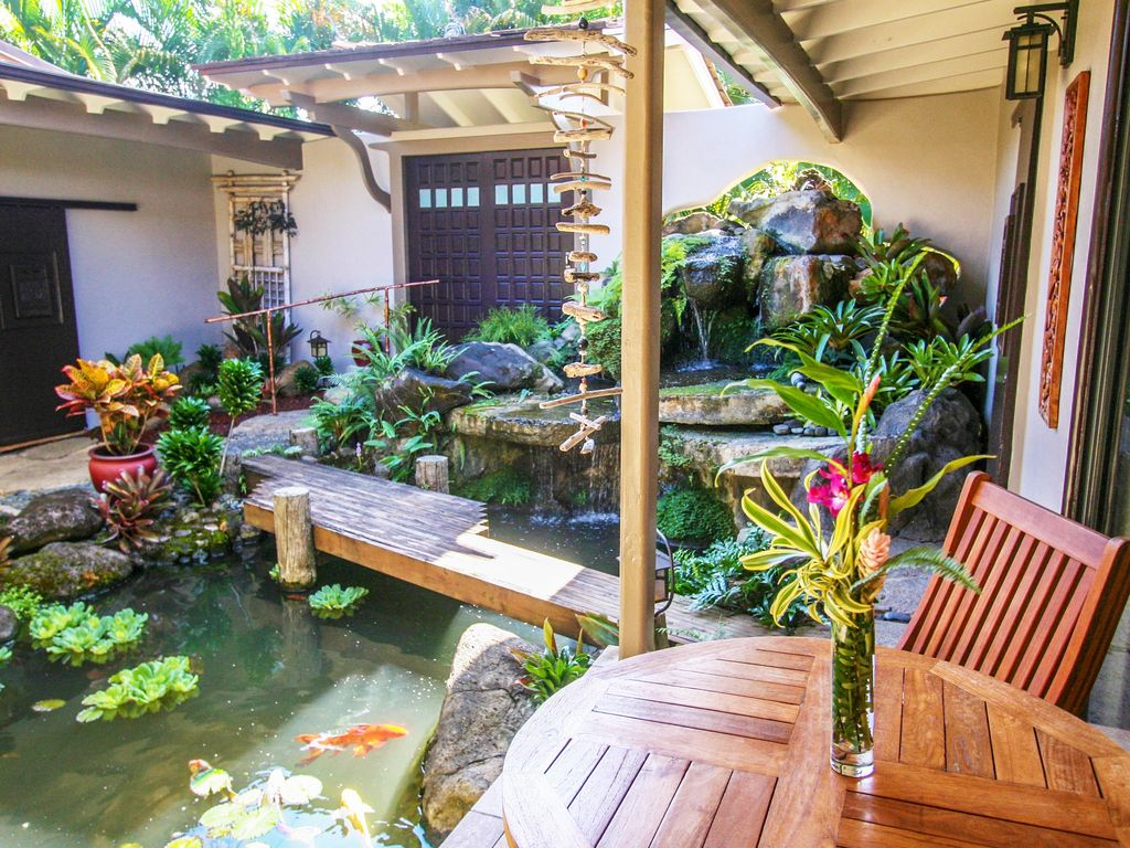 North shore oasis tropical waterfall garden vrbo for Tropical house plans with courtyards