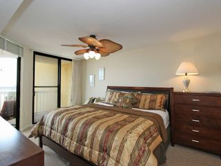 Master Bedroom suite with King bed & huge HD TV - Folly Beach condo vacation rental photo