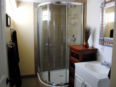 Private downstairs bath with luxurious towels and walk-in shower.