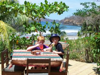 Playa Hermosa house photo - Our boys at one of their favorite beachfront restaurants in Playa Hermosa.