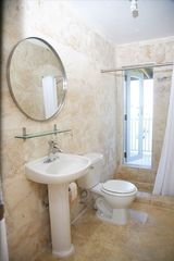 Isabela apartment photo - New bathrooms. Travertine marble floors.