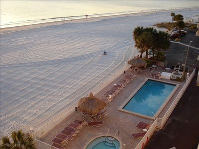 View of gulf waters,beach, hot tub, tiki huts and heated pool from our balcony.