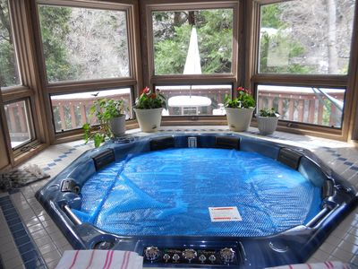 Indoor Jacuzzi with large deck outside and living room and 2 large bath rooms