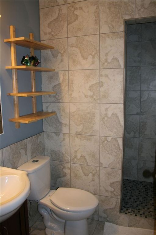 Large rain shower bathroom on upper level