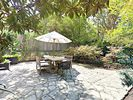 Patio - In the quiet backyard, find some shade at the large table