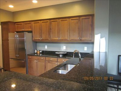Open kitchen with granite and ss appliances including dishwasher & gas stove