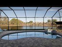 Luxurious contemporary lakeside villa with pool/spa in a gated golf community