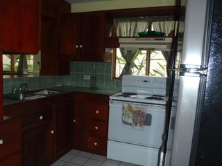 Playa Flamingo condo photo - Kitchen with electric stove, side by side refrig.& everything you need!