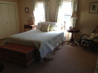 Rumney farmhouse photo - The master bedroom is 15 x 18 with views of the orchards and mountains!