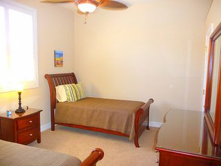 Cape Coral house photo - Twin guest room with walk-in closet and cooling ceiling fan