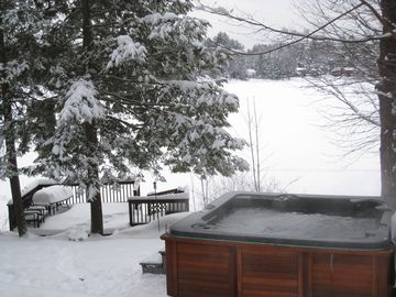 Winter backyard with hot tub.