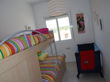 triple beds and cot in bedroom 3