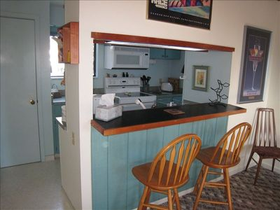 View Kitchen/Breakfast bar. Note: Carpeting is now hardwood.