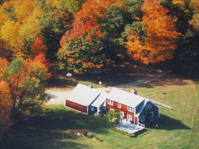 An aerial view of the house and the gorgeous foliage of fall.
