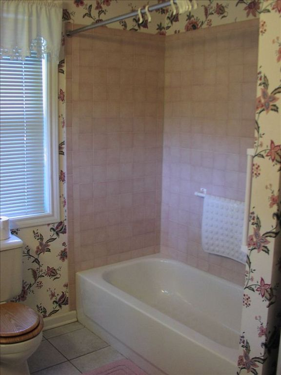Tub and shower in the master suite bathroom