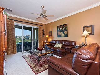 Ormond Beach condo photo - Living room is bright and sunny and beautifully furnished.