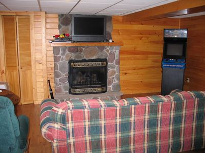 Game room with pullout couch and cozy fireplace, Old school video game machine