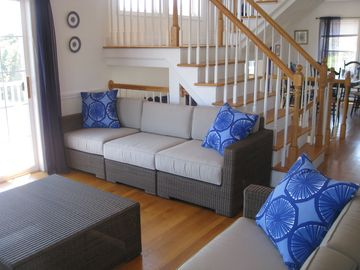 Living room seating area with sliders onto the deck.