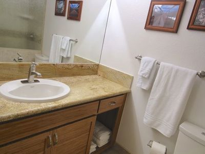Master Bath vanity with granite countertop and custom bamboo cabinets.