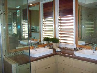 Kekaha villa photo - upstairs bathroom framless glass shower/vessel sinks