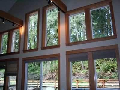 Great Room wall of windows - looks upon a beautiful wooded hillside