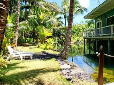 Tropical tiki hut over the pond with a great grassy sunning area