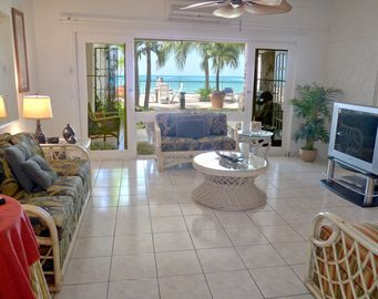 Good sized living room with beautiful view of ocean and beach.