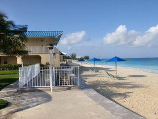 Grand Cayman condo photo - Beach with umbrellas and loungers