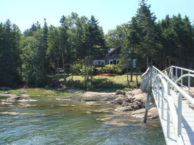 3 acre oceanfront contemporary, 400 ft beach, deck, deep water dock & mooring.