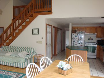 View from dining area to the kitchen and hallway to porch.