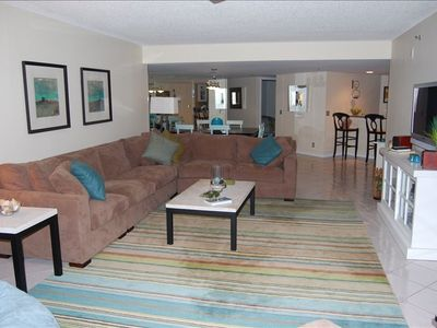 Living room complete with ocean views, flat screen tv & L shape sectional!