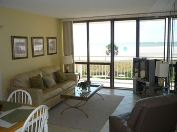 Living room looking out onto balcony with beach view