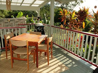 Wood Valley Pahala cottage photo - Breakfast on the lanai is one of the favorite moments of the day.