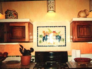 Sayulita house photo - COOKTOP IN KITCHEN, WITH HANDMADE TILE BACKGROUND