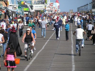 Walkers, bikers and joggers enjoying the boardwalk.