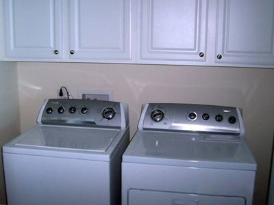 Separate Laundry Room With Full Size Washer & Dryer