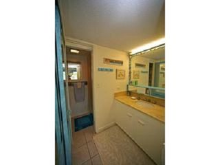Hauula condo photo - Bathroom with separate vanity-sink, WC + tub/shower rooms.