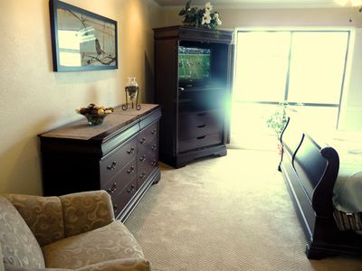 Entertainment armoire and sitting area