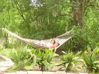 New Braunfels estate photo - Relaxing hammock holds two - west side backyard