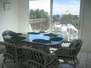 St George Island house photo - This photo is taken from kitchen, towards a dining room, East deck and the Gulf