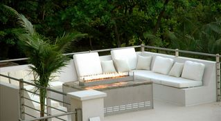 Rooftop lounging by the firepit - Roatan hotel vacation rental photo