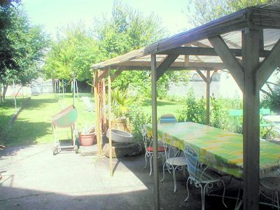 Large, safe garden with covered eating area