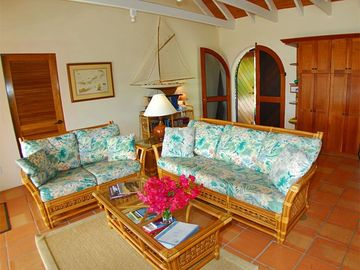 You enter a charming, Caribbean-style living room