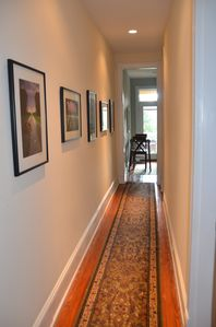 Beautiful second level hallway with photos by local photographer