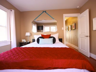 he bedroom is eclectically accented with bold yet soothing colors.