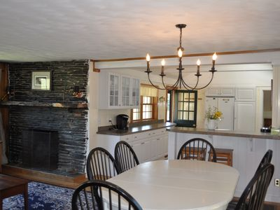 open dining, kitchen and living area with flagstone fireplace
