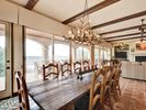 Dining Area - This rustic dining area is a great place to enjoy home-cooked meals with views of Lake Travis.