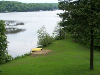 Elkhorn house photo - The canoe and kayaks are in the boat house waiting to go out. Dock not pictured.